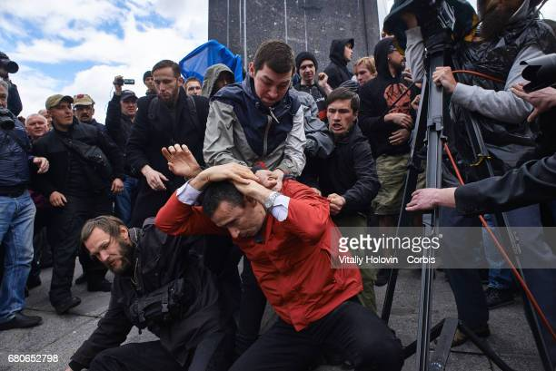 Ukrainian patriots fight with proRussian activists during Victory Day celebrations in front of the Tomb of the Unknown Soldier on May 9 2017 in Kiev...