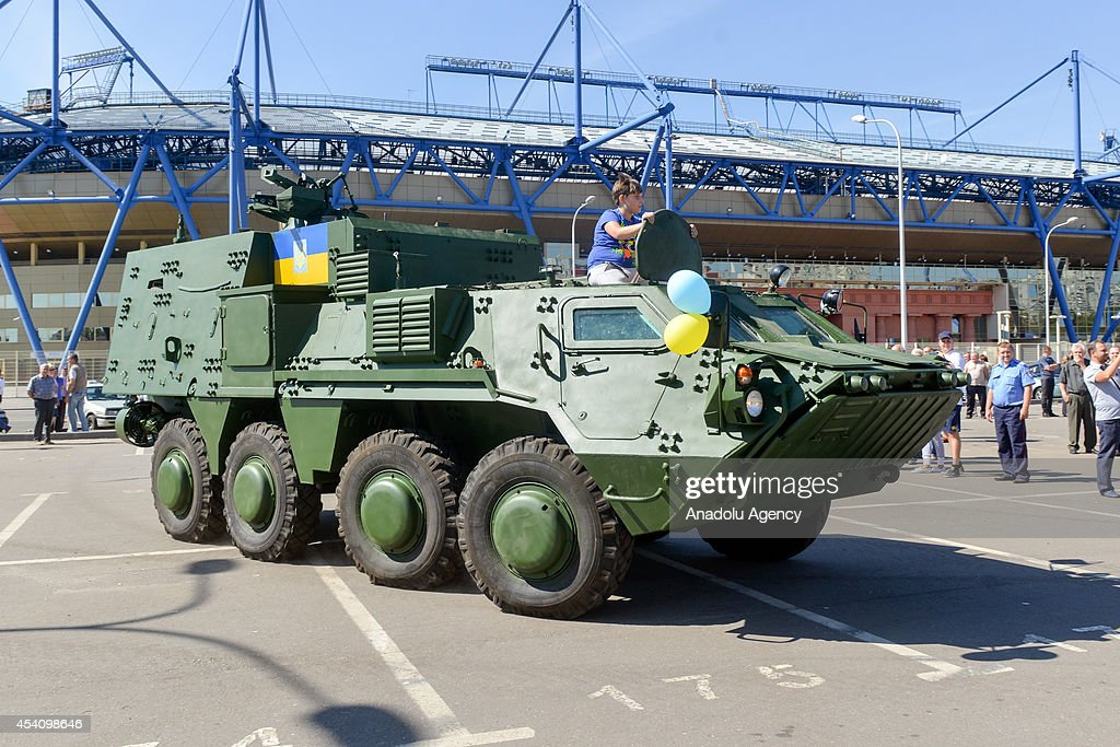 Ukrainian people visit the area near Metalist Kharkov Stadium where Ukraine's new military vehicles are displayed within the Independence Day celebrations in Kharkov, Ukraine on August 24, 2014. As the operations against pro-Russian separatists keep going on in eastern Ukraine, Independence Day celebrations are held in the capital Kiev, coastal town Odessa and in other cities.