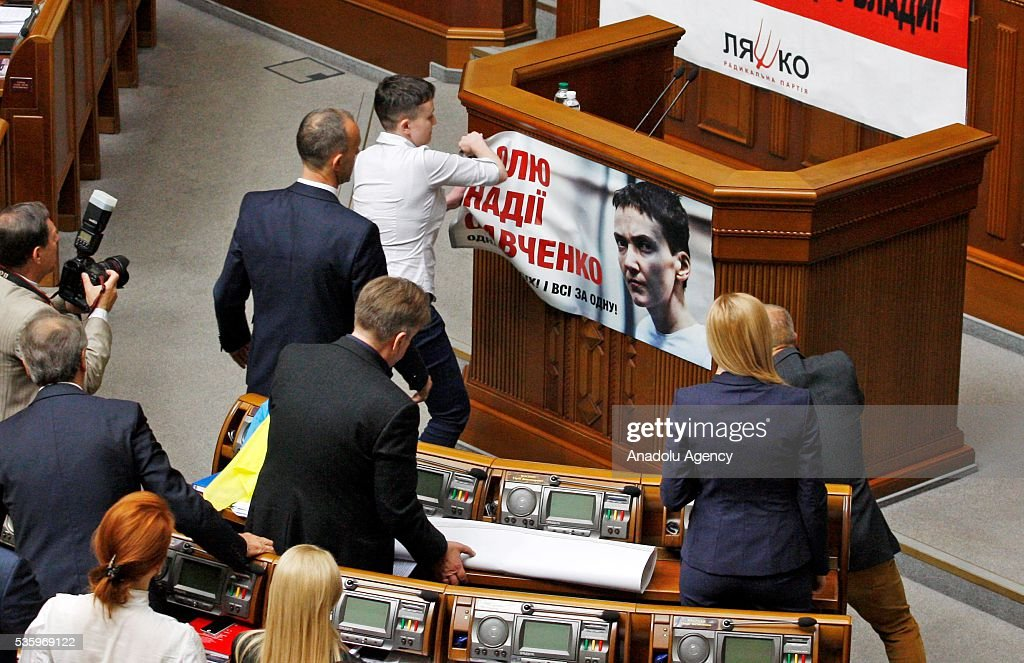 Ukrainian pilot and Ukrainian parliament member Nadiya Savchenko (C) takes away a poster with her photo from the rostrum during a session of Parliament, in Kiev, Ukraine on May 31, 2016.