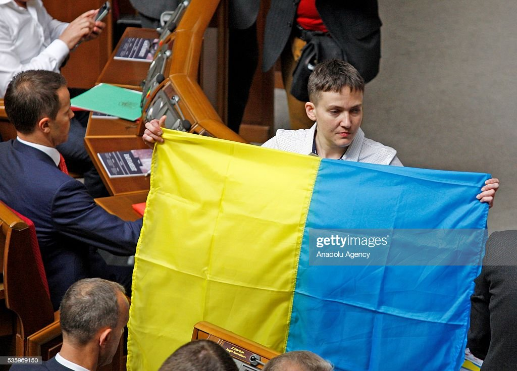 Ukrainian pilot and Ukrainian parliament member Nadiya Savchenko holds a national flag during a session of Parliament in Kiev, Ukraine on May 31, 2016.