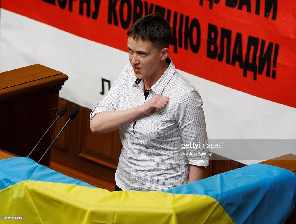 Ukrainian pilot and Ukrainian parliament member Nadiya Savchenko sings the national anthem of Ukraine during a session of Parliament, in Kiev, Ukraine on May 31, 2016.