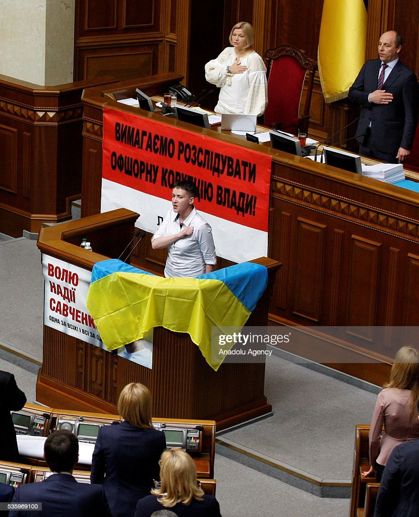 Ukrainian pilot and Ukrainian parliament member Nadiya Savchenko sings the national anthem of Ukraine together with the lawmakers during a session of Parliament, in Kiev, Ukraine on May 31, 2016.