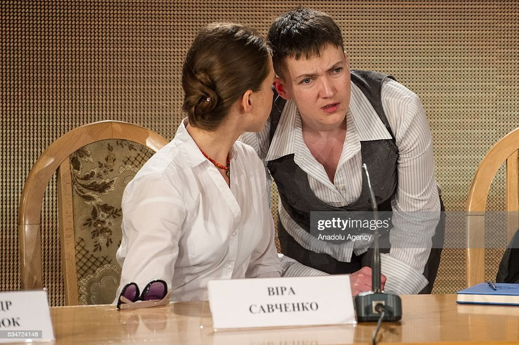 Ukrainian pilot, member of the Ukrainian parliament and member of the Ukrainian delegation to PACE, Nadiya Savchenko (R) talks to her sister Vira before her press conference in Kiev, Ukraine, on May 27, 2016.