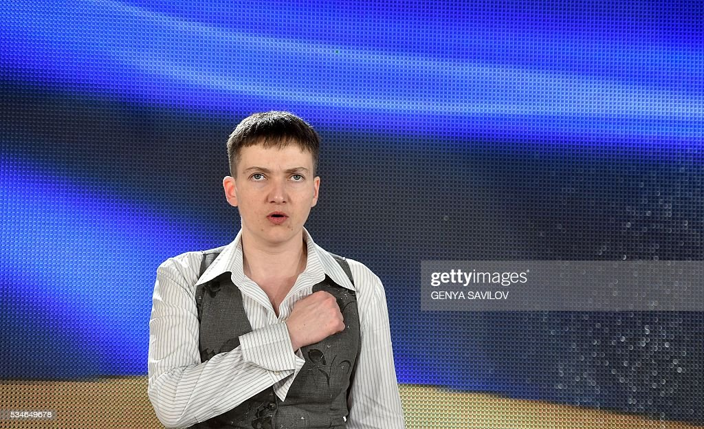 Ukrainian pilot Nadiya Savchenko sings national anthem during a press conference in Kiev on May 27, 2016. Savchenko returned home to a hero's welcome on May 25 after nearly two years in a Russian jail following a prisoner swap with Moscow that drew a line under a major diplomatic spat. The 35-year-old army helicopter pilot flew home as part of a carefully choreographed exchange with Moscow, with two alleged Russian soldiers leaving Ukraine earlier in the day SAVILOV