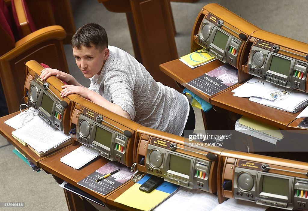 Ukrainian pilot Nadiya Savchenko sits in Parliament during a session break on May 31, 2016 in Kiev. Savchenko was taking part today in a Parliament session as Ukrainian MP. The 35-year-old army helicopter pilot, elected as an MP in absentia during almost two years in a Russian jail, also raised the possibility she could run for president. / AFP / GENYA