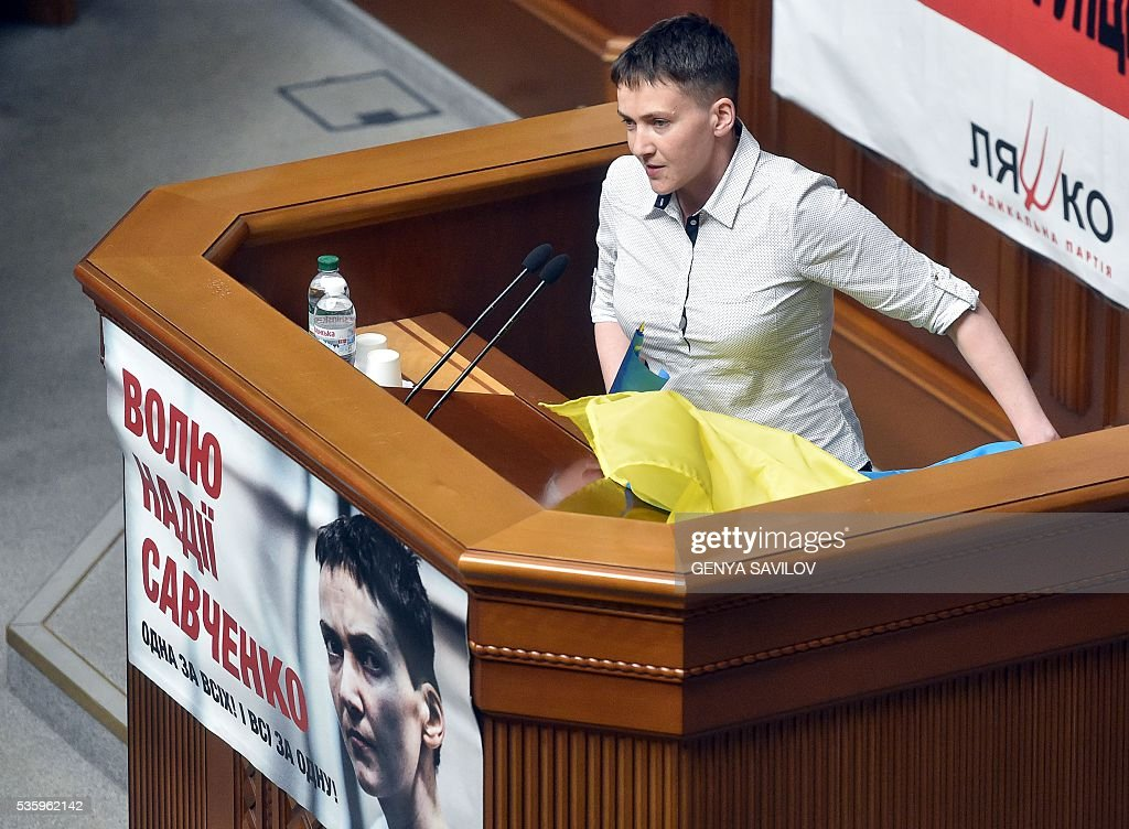 Ukrainian pilot Nadiya Savchenko speaks from a rostrum at the Ukrainian Parliament in Kiev on May 31, 2016. Savchenko takes part today in a Parliament session as Ukrainian MP. The 35-year-old army helicopter pilot, elected as an MP in absentia during almost two years in a Russian jail, also raised the possibility she could run for president. / AFP / GENYA