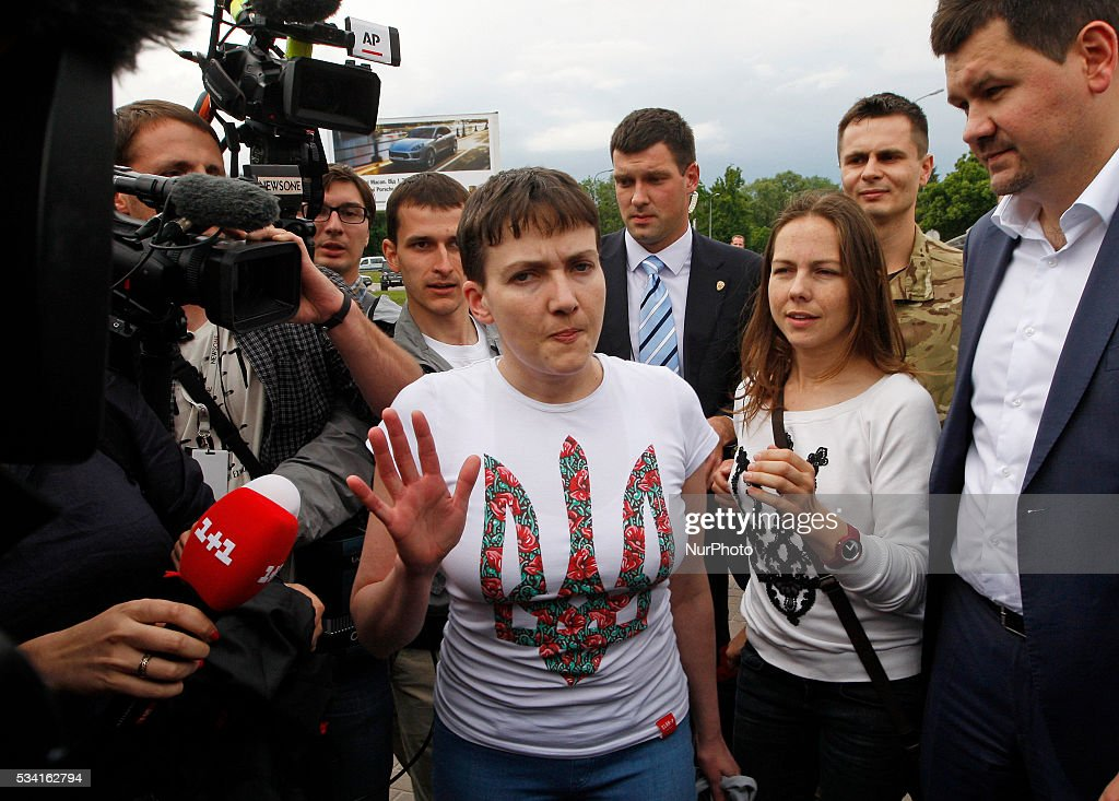 Ukrainian pilot <a gi-track='captionPersonalityLinkClicked' href=/galleries/search?phrase=Nadiya+Savchenko&family=editorial&specificpeople=13678531 ng-click='$event.stopPropagation()'>Nadiya Savchenko</a> (C),speaks with journalists after arriving at the Boryspil International airport,near Kiev, Ukraine, 25 May 2016. Savchenko was exchanged for two Russian officers Alexander Alexandrov and Yevgeniy Yerofeyev.