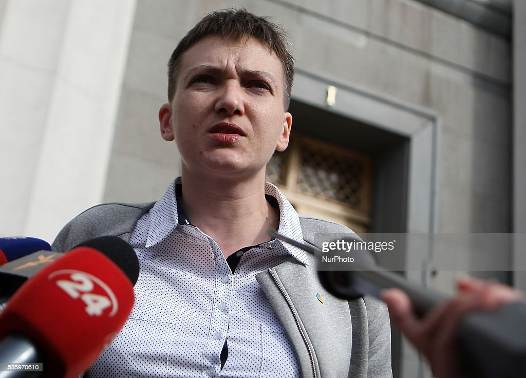 Ukrainian pilot Nadiya Savchenko speaks with members of the press at the Ukrainian parliament in Kiev, Ukraine, Tuesday, May 31, 2016. Savchenko appeared for her first session at the Ukrainian parliament as a lawmaker in former Prime Minister Yulia Tymoshenko's party on Tuesday. Nadiya Savchenko, the Ukrainian military pilot who became a national hero in her homeland during two years of detention by Russia, was released Wednesday, 25th May 2016.