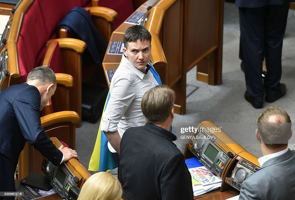 Ukrainian pilot Nadiya Savchenko (C) stands in a hall of the Ukrainian Parliament in Kiev on May 31, 2016. Savchenko takes part today in a Parliament session as Ukrainian MP. The 35-year-old army helicopter pilot, elected as an MP in absentia during almost two years in a Russian jail, also raised the possibility she could run for president. / AFP / GENYA