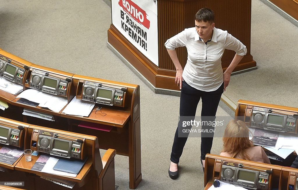 Ukrainian pilot Nadiya Savchenko stands in Parliament during a session break on May 31, 2016 in Kiev. Savchenko was taking part today in a Parliament session as Ukrainian MP. The 35-year-old army helicopter pilot, elected as an MP in absentia during almost two years in a Russian jail, also raised the possibility she could run for president. / AFP / GENYA