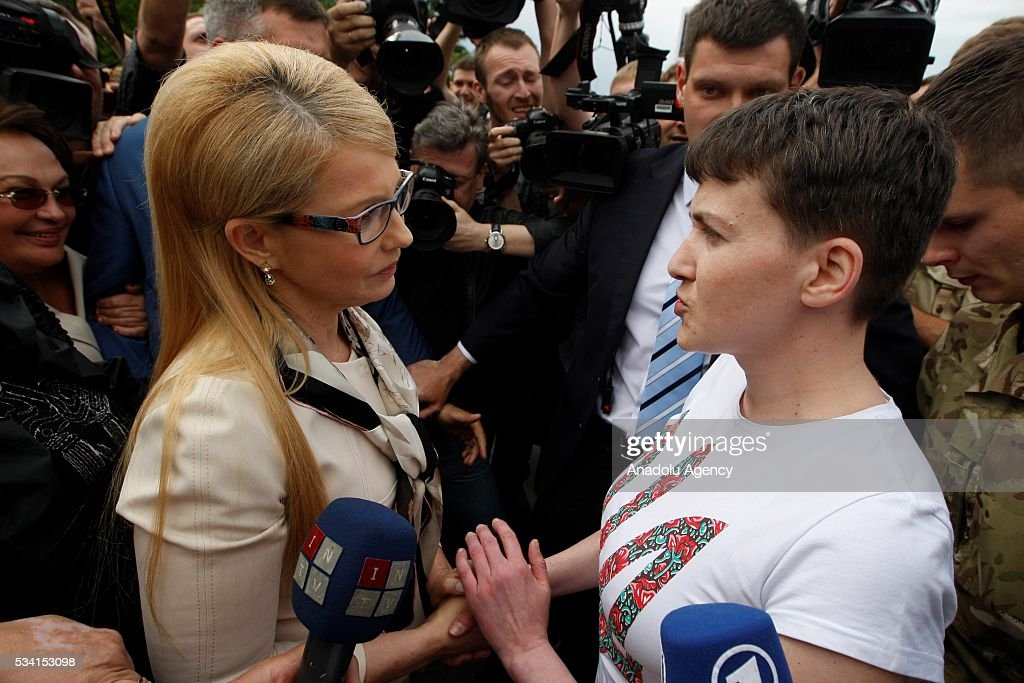 Ukrainian pilot Nadiya Savchenko (R) talks with the Leader of 'Batkivschina' party Yulia Tymoshenko (L) at Kyiv Boryspil Airport upon Nadiya's arrival on May 25, 2016 in Boryspil, Ukraine.