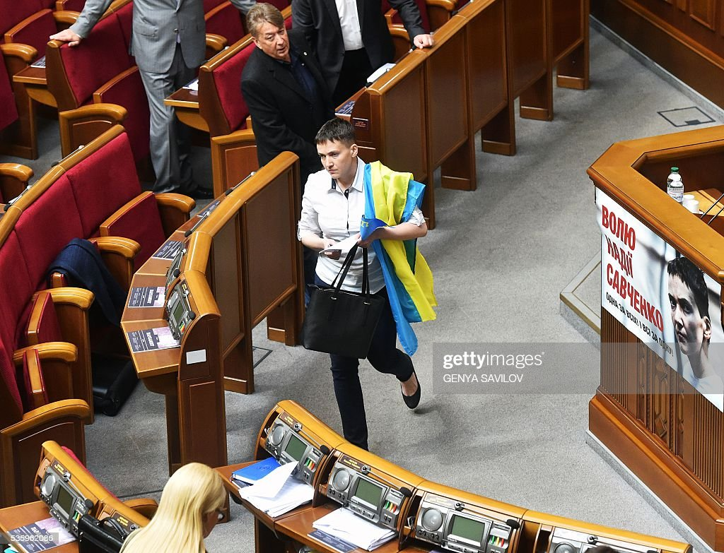 Ukrainian pilot Nadiya Savchenko walks at the Ukrainian Parliament in Kiev on May 31, 2016. Savchenko takes part today in a Parliament session as Ukrainian MP. The 35-year-old army helicopter pilot, elected as an MP in absentia during almost two years in a Russian jail, also raised the possibility she could run for president. / AFP / GENYA