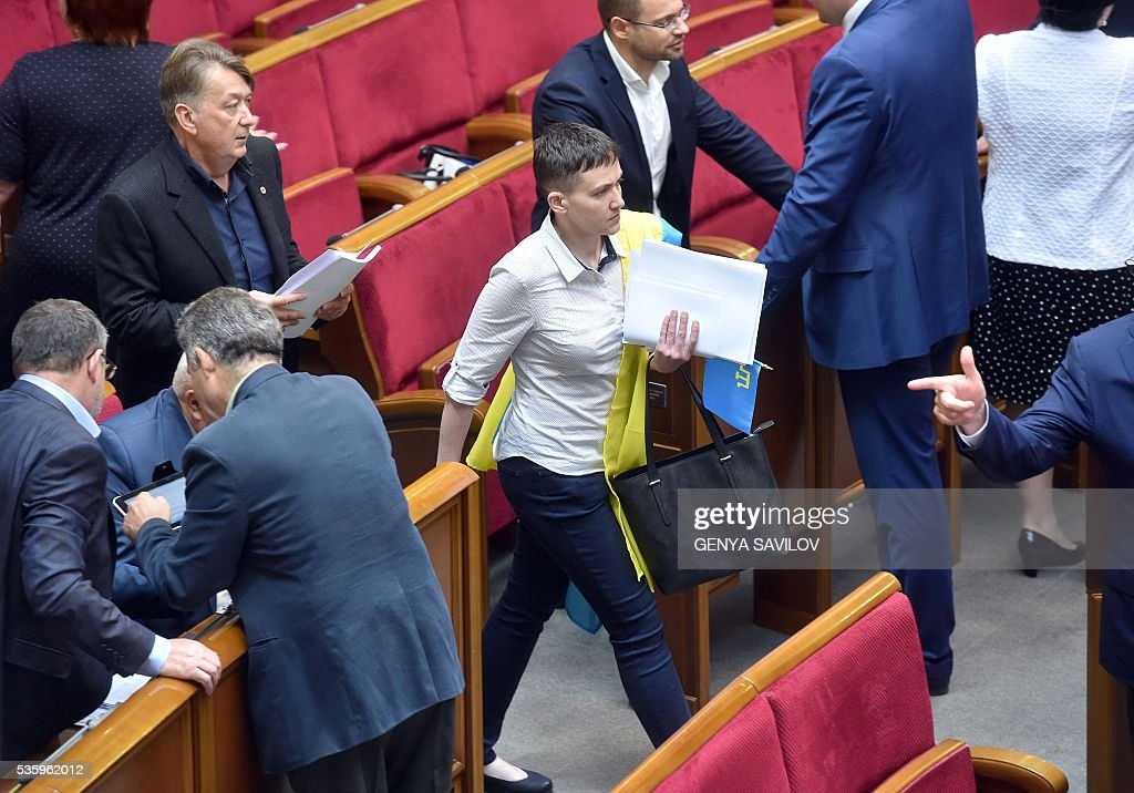 Ukrainian pilot Nadiya Savchenko (C) walks in a hall of the Ukrainian Parliament in Kiev on May 31, 2016. Savchenko takes part today in a Parliament session as Ukrainian MP. The 35-year-old army helicopter pilot, elected as an MP in absentia during almost two years in a Russian jail, also raised the possibility she could run for president. / AFP / GENYA