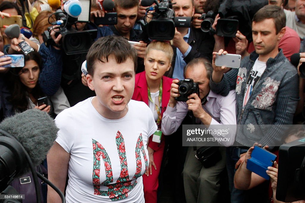 Ukrainian pilot Nadiya Savchenko, who was freed from jail in Russia as part of a prisoner exchange, talks to the media upon arrival at Kiev's Boryspil airport on May 25, 2016. Ukrainian pilot Nadiya Savchenko, who had spent nearly two years in a Russian prison, returned home to a hero's welcome on May 25, drawing the curtain on one of the most serious diplomatic problems between Moscow and Kiev. The 35-year-old army helicopter pilot returned home as part of an apparent swap with Moscow, after two alleged Russian soldiers, Aleksandr Aleksandrov and Yevgeny Yerofeyev, left Ukraine earlier in the day. / AFP / ANATOLII