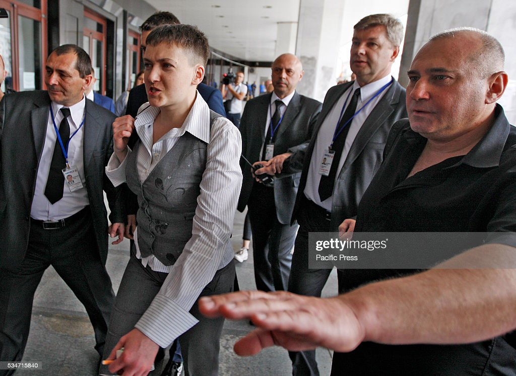 Ukrainian pilot Nadiya Savchenko (C), who was freed from prison in Russia walks after her press conference in Kiev, Ukraine. Savchenko returned home as she was exchanged for two alleged Russian soldiers, Aleksander Aleksandrov and Yevgeny Yerofeyev on May 25.