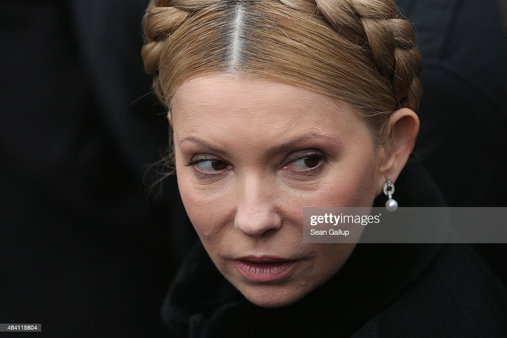 Ukrainian politician <a gi-track='captionPersonalityLinkClicked' href=/galleries/search?phrase=Yulia+Tymoshenko&family=editorial&specificpeople=546280 ng-click='$event.stopPropagation()'>Yulia Tymoshenko</a> arrives to participate in the 'March of Diginity' prior to ceremonies marking the first anniversary of the Maidan revolution that led to the ouster of Ukrainian President Viktor Yanukovich one year ago at Maidan Independence Square on February 22, 2015 in Kiev, Ukraine. Meanwhile Ukrainian government forces and pro-Russian separatists have exchanged prisoners in a hopeful sign that the recent Minsk ceasefire agreements might still have a chance.