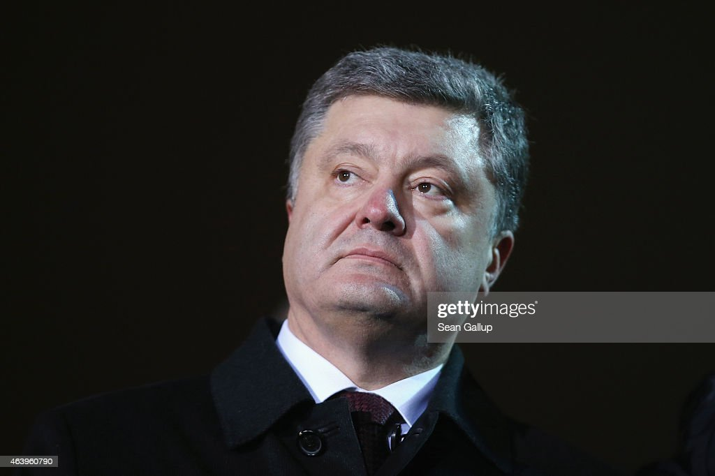 Ukrainian President Petro Porosehnko attends an evening ceremony to commemorate victims of the Maidan uprising one year ago at Maidan square on February 20, 2015 in Kiev, Ukraine. Ukraine is commemorating the first anniversary of the February 20, 2014 sniper attacks that killed dozens of protesters on the Maidan and were followed by the ouster of Ukrainian President Viktor Yanukovich shortly later. Meanwhile fighting between pro-Ukrainian troops and pro-Russian separatists is continuing in the Donbas region of eastern Ukraine despite the recent Minsk ceasefire agreements.