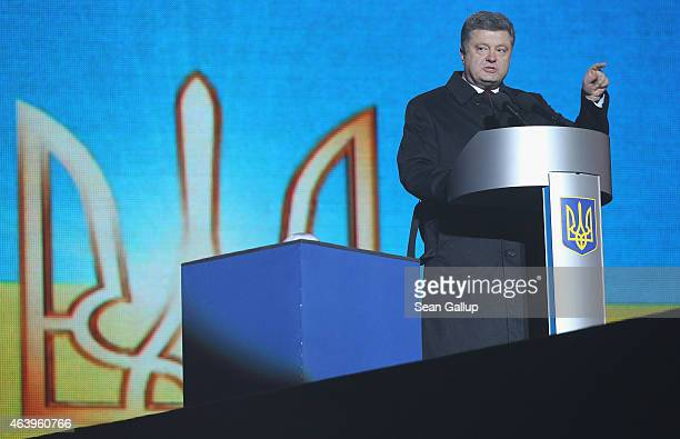 Ukrainian President Petro Porosehnko speaks at an evening ceremony to commemorate victims of the Maidan uprising one year ago at Maidan square on...