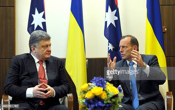 Ukrainian President Petro Poroshenko and Australian Prime Minister Tony Abbott talk during a meeting at the Federal Government offices on December 11...