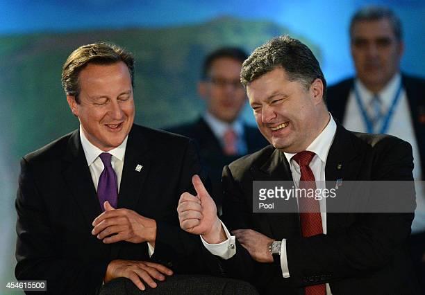 Ukrainian President Petro Poroshenko and British Prime Minister David Cameron talk during the NATO Summit on September 4 2014 in Newport Wales...