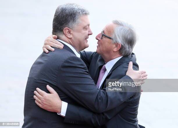 Ukrainian President Petro Poroshenko and European Commission President JeanClaude Juncker embrace before the EUUkraine summit in Kiev UkraineThursday...