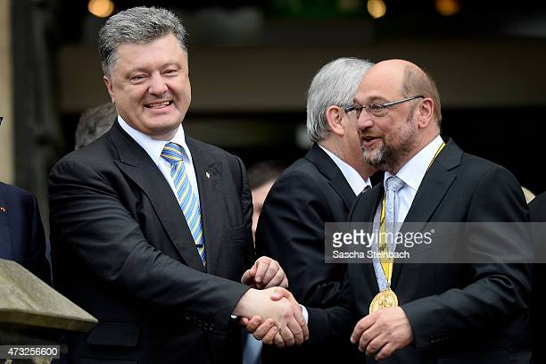 Ukrainian President Petro Poroshenko and European Parliament President Martin Schulz shake hands during the International Charlemange Prize Of Aachen...