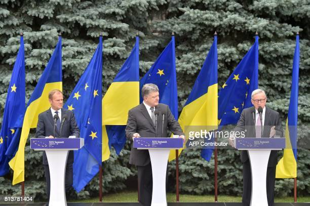 Ukrainian President Petro Poroshenko and President of the European Council Donald Tusk listen to the President of the European Commission JeanClaude...