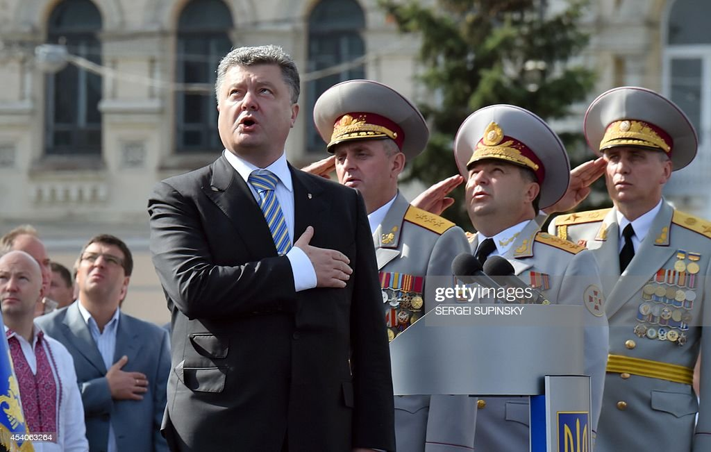 Ukrainian President Petro Poroshenko and the supreme command staff sing the national anthem during a military parade marking the 23rd anniversary of Ukraine's independence in the center of Kiev on August 24, 2014. Ukraine's President Petro Poroshenko on Sunday decried Russian 'aggression' as Kiev staged a symbolic Independence Day parade while battling pro-Moscow rebels in the east of the country.