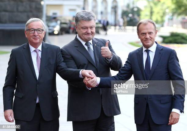 Ukrainian President Petro Poroshenko center European Council President Donald Tusk right and European Commission President JeanClaude Juncker shakes...