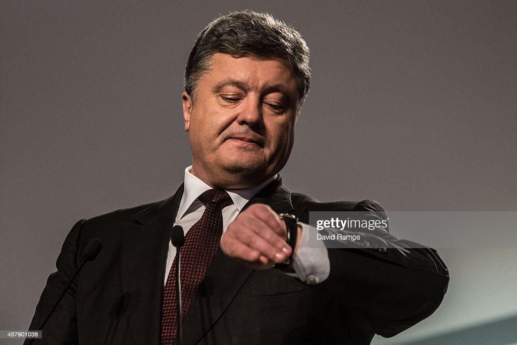 Ukrainian President <a gi-track='captionPersonalityLinkClicked' href=/galleries/search?phrase=Petro+Poroshenko&family=editorial&specificpeople=549382 ng-click='$event.stopPropagation()'>Petro Poroshenko</a> checks his watch as he speaks to the media on October 26, 2014 in Kiev, Ukraine. Although a low turn out is expected in the east of the country, amid continued fighting between Ukrainian forces and pro-Russian seperatists, Ukraine is expected to elect a pro-western parliament in a further move away from Russian influence.