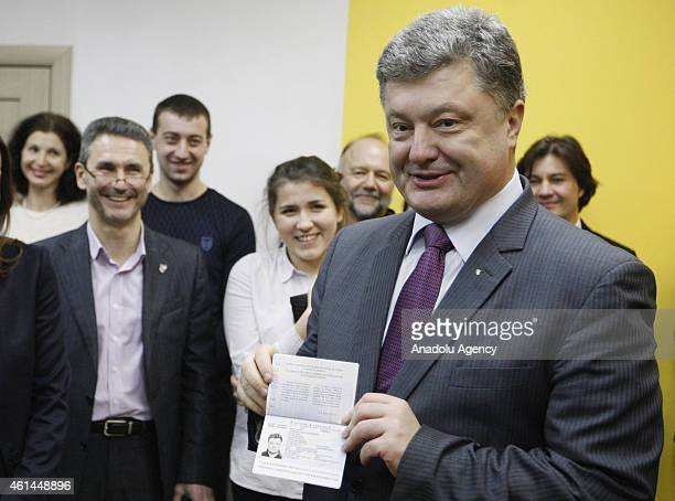 Ukrainian President Petro Poroshenko comes to Kiev Police Headquarters' passport office with the Ukrainian prominent scientists people took place in...