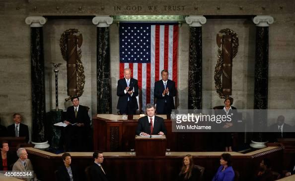 Ukrainian President Petro Poroshenko flanked by US Vice President Joe Biden and Speaker of the House John Boehner addresses a joint meeting of the US...