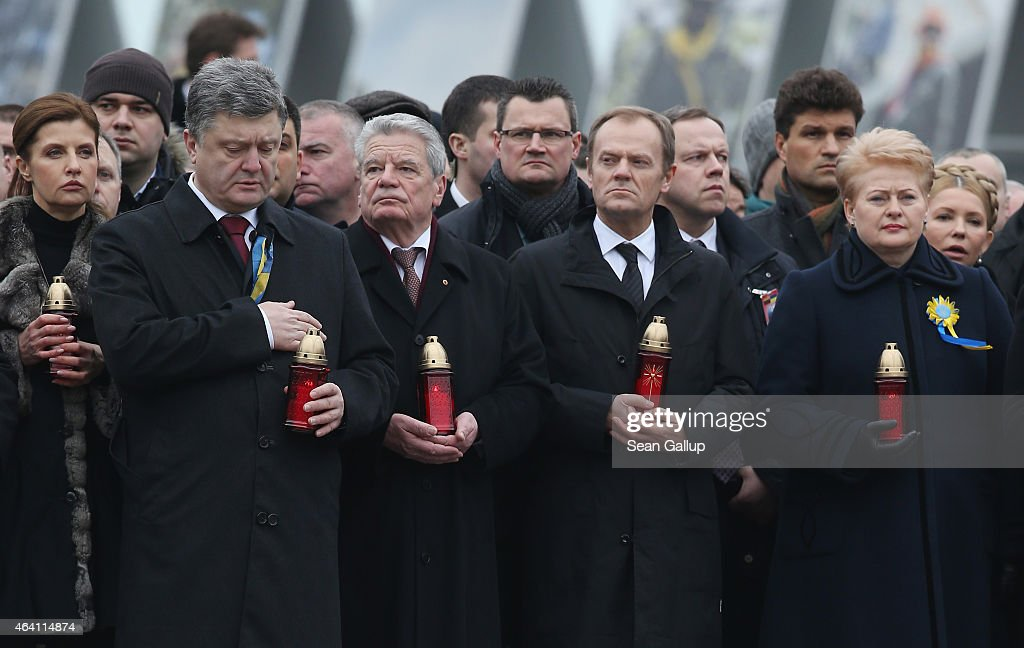 Ukrainian President <a gi-track='captionPersonalityLinkClicked' href=/galleries/search?phrase=Petro+Poroshenko&family=editorial&specificpeople=549382 ng-click='$event.stopPropagation()'>Petro Poroshenko</a>, German President <a gi-track='captionPersonalityLinkClicked' href=/galleries/search?phrase=Joachim+Gauck&family=editorial&specificpeople=2077888 ng-click='$event.stopPropagation()'>Joachim Gauck</a>, European Council President <a gi-track='captionPersonalityLinkClicked' href=/galleries/search?phrase=Donald+Tusk&family=editorial&specificpeople=870281 ng-click='$event.stopPropagation()'>Donald Tusk</a> and Lithuanian President <a gi-track='captionPersonalityLinkClicked' href=/galleries/search?phrase=Dalia+Grybauskaite&family=editorial&specificpeople=654850 ng-click='$event.stopPropagation()'>Dalia Grybauskaite</a> attend ceremonies marking the first anniversary of the Maidan revolution that led to the uoster of Ukrainian President Viktor Yanukovich one year ago at Maidan Independence Square on February 22, 2015 in Kiev, Ukraine. Meanwhile Ukrainian government forces and pro-Russian separatists have exchanged prisoners in a hopeful sign that the recent Minsk ceasefire agreements might still have a chance.