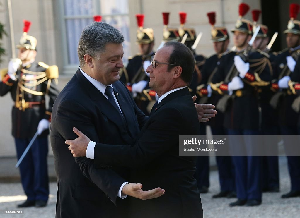 Ukrainian President Petro Poroshenko (R) greets French President Francois Hollande (L) prior to their meeting at the Elysee Presidential Palace on October 02, 2015 in Paris, France. The leaders of France, Germany, Russia and Ukraine are meeting in Paris to consolidate a fragile peace in Ukraine, as a conflict that appears to be winding down is overshadowed by President Vladimir Putin's dramatic intervention in Syria's war.