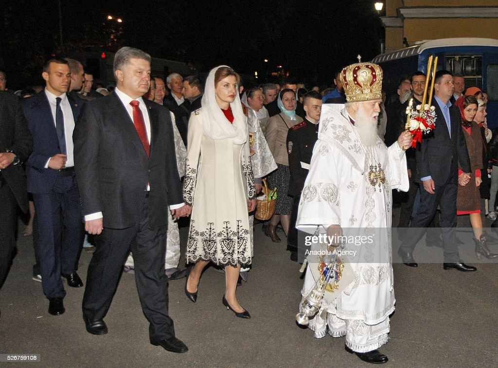 Ukrainian President Petro Poroshenko (L),his wife Maryna (C) and the Head of Ukrainian Orthodox Church Patriarch Filaret (R) attend Orthodox Easter service at St. Volodymyr cathedral in Kiev, Ukraine,on May 01, 2016.