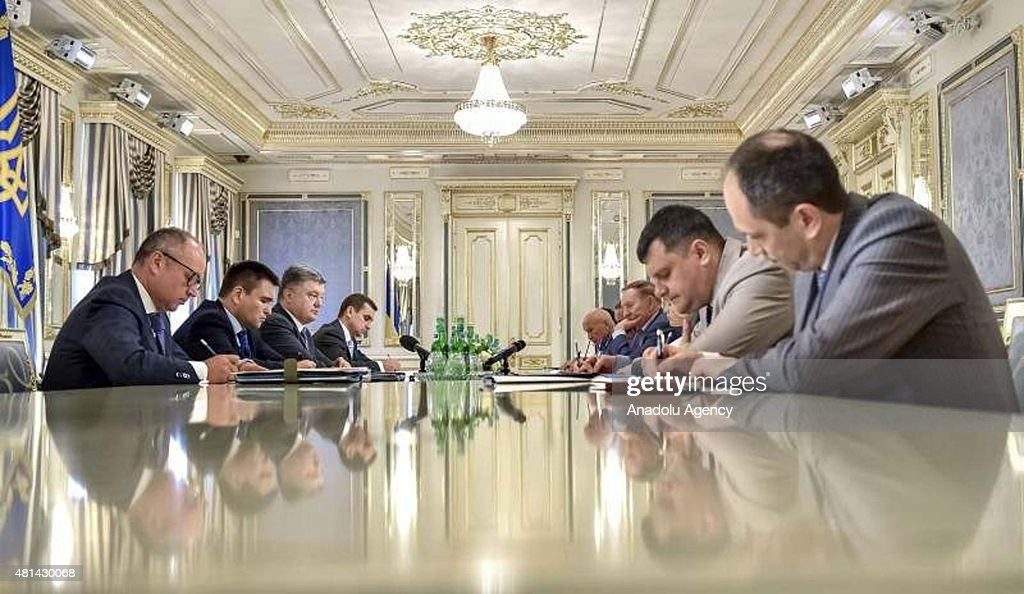 Ukrainian President Petro Poroshenko meets a Ukrainian delegation which will attend the Trilateral Contact Group meeting in Minsk in Kiev Ukraine on...