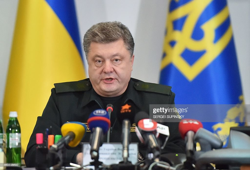 Ukrainian President Petro Poroshenko orders the military to implement a ceasefire during a live broadcast in Kiev early on February 15, 2015. The peace process in Ukraine is being 'threatened' by pro-Russian separatists who have virtually encircled Ukrainian troops in the key battleground town of Debaltseve, President Petro Poroshenko said early on February 15, shortly after the start of an agreed ceasefire.