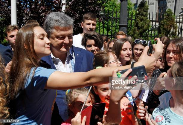 Ukrainian President Petro Poroshenko poses for a photo with Ukrainian youth during a ceremony of start to a symbolic 'visafree timer' at the...