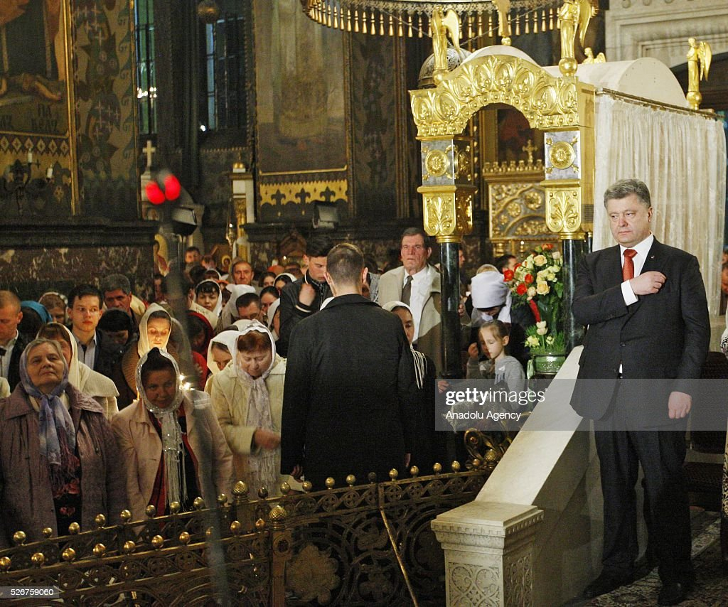 Ukrainian President Petro Poroshenko prays during Orthodox Easter service at St. Volodymyr cathedral in Kiev, Ukraine,on May 01,2016.