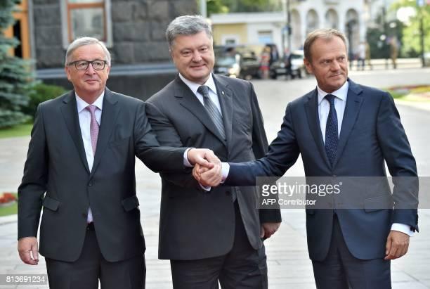 Ukrainian President Petro Poroshenko President of the European Council Donald Tusk and JeanClaude Juncker President of the European Commission pose...