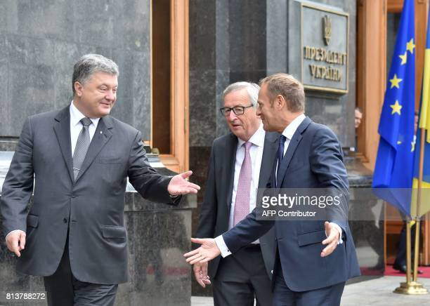 Ukrainian President Petro Poroshenko President of the European Council Donald Tusk and the President of the European Commission JeanClaude Juncker...