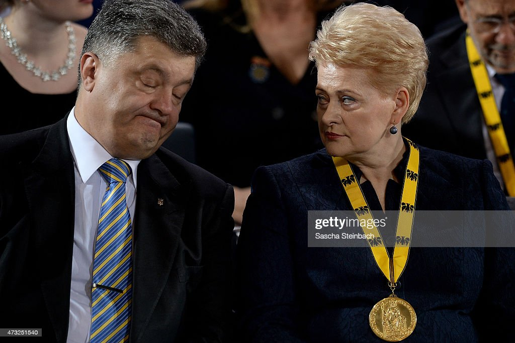Ukrainian President <a gi-track='captionPersonalityLinkClicked' href=/galleries/search?phrase=Petro+Poroshenko&family=editorial&specificpeople=549382 ng-click='$event.stopPropagation()'>Petro Poroshenko</a> talks to Lithuanian President <a gi-track='captionPersonalityLinkClicked' href=/galleries/search?phrase=Dalia+Grybauskaite&family=editorial&specificpeople=654850 ng-click='$event.stopPropagation()'>Dalia Grybauskaite</a> during the International Charlemange Prize Of Aachen 2015 (Der Internationale Karlspreis zu Aachen) on May 14, 2015 in Aachen, Germany. The International Charlemagne Prize, one of the most prestigious European prizes, is awarded once a year since 1950 by the city of Aachen to people for distinguished service on behalf of European unification.