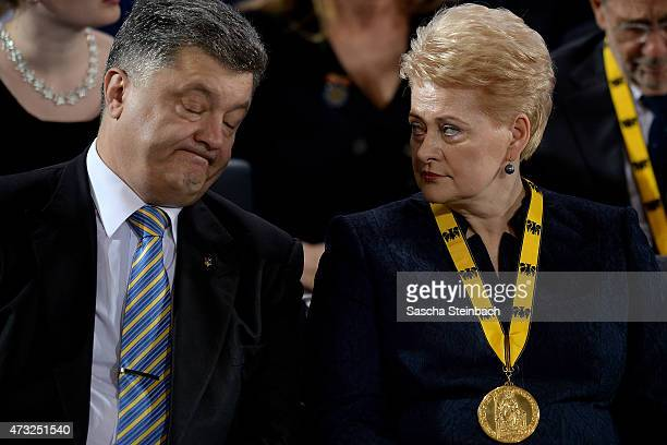 Ukrainian President Petro Poroshenko talks to Lithuanian President Dalia Grybauskaite during the International Charlemange Prize Of Aachen 2015 on...
