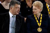 Ukrainian President Petro Poroshenko talks to Lithuanian President Dalia Grybauskaite during the International Charlemange Prize Of Aachen 2015 on...