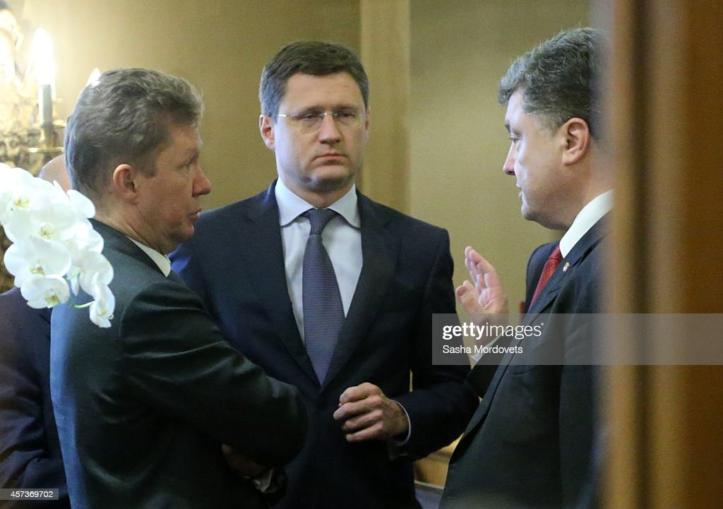 Ukrainian President Pyotr Poroshenko (R) talks to Gazprom's CEO <a gi-track='captionPersonalityLinkClicked' href=/galleries/search?phrase=Alexei+Miller&family=editorial&specificpeople=713081 ng-click='$event.stopPropagation()'>Alexei Miller</a> (L) and Russian Minister of Energy Alexander Novak (C) during the ASEM Summit on October 17, 2014 in Milan, Italy. The Asia-Europe Meeting (ASEM) was initiated in 1996 when the ASEM leaders met in Bangkok, Thailand. ASEM is an informal trans-regional platform for dialogue and cooperation between Asia and Europe with 50 heads of state attending.