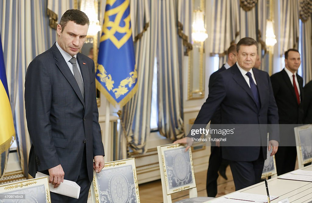 Ukrainian President <a gi-track='captionPersonalityLinkClicked' href=/galleries/search?phrase=Viktor+Yanukovych&family=editorial&specificpeople=717883 ng-click='$event.stopPropagation()'>Viktor Yanukovych</a> (R) and <a gi-track='captionPersonalityLinkClicked' href=/galleries/search?phrase=Vitali+Klitschko&family=editorial&specificpeople=206402 ng-click='$event.stopPropagation()'>Vitali Klitschko</a>, leader of Ukraine's UDAR opposition party arrives before the signing of the Agreement in the Presidential Palace on February 21, 2014 in Kiev, Ukraine. Yesterday Steinmeier and his counterparts from France and Poland meet with President Yanukovych and other government officials and hold separate talks with the opposition.