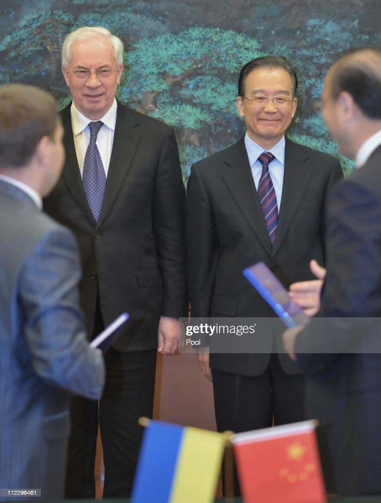 Ukrainian Prime Minister <a gi-track='captionPersonalityLinkClicked' href=/galleries/search?phrase=Mykola+Azarov&family=editorial&specificpeople=764965 ng-click='$event.stopPropagation()'>Mykola Azarov</a> and Chinese Premier <a gi-track='captionPersonalityLinkClicked' href=/galleries/search?phrase=Wen+Jiabao&family=editorial&specificpeople=204598 ng-click='$event.stopPropagation()'>Wen Jiabao</a> during their signing ceremony for a joint statement on bilateral cooperation in the Great Hall of the People on April 18, 2011 in Beijing, China.