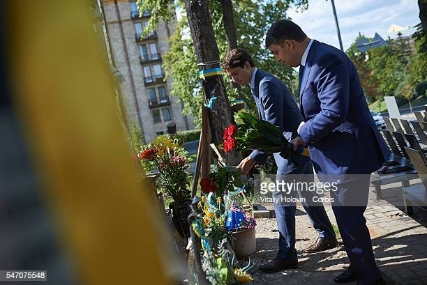 Ukrainian Prime Minister Volodymyr Groysman with his Canadian counterpart Justin Trudeau visit the memorial to victims of antigovernment protests on...