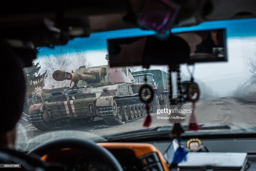 A Ukrainian self-propelled gun drives on the road away from the embattled town of Debaltseve on February 14, 2015 in Artemivsk, Ukraine. A ceasefire between Ukrainian forces and pro-Russian rebels is scheduled to go into effect at midnight.