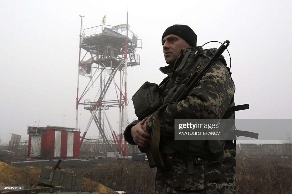 Ukrainian serviceman guards at hydrometeorological station tower at the airport of eastern Ukrainian city of Donetsk on December 11 2014 President...